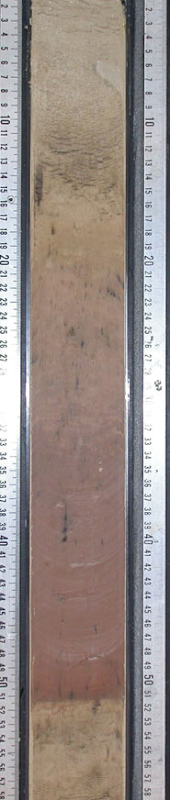 Sediment core spanning the Paleocene-Eocene greenhouse warming event 55 million years ago. The sharp transition from carbonate-rich shell sediments (grey-white) to pure clay (red) indicates the dissolution of carbonates due to ocean acidification.Photo by Daniela Schmidt on board the JOIDES Resolution Drill Ship.