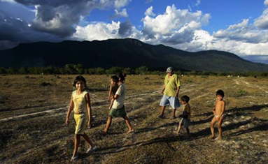 An indigenous Macuxi family walks in the Raposa Serra do Sol reservation in Roraima state, Brazil. Photograph: Marlene Bergamo/AP