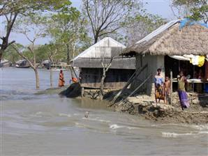 Water lapping homes in Garbura, Bangladesh. Ian Williams