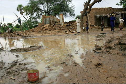 A photograph released by Oxfam of people near Zinder, Niger, where heavy rains and flooding are compounding food shortages caused by a prolonged drought. Agence France-Presse / Getty Images