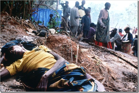 Rwandan refugees passed a body in a refugee camp in Congo in 1997.