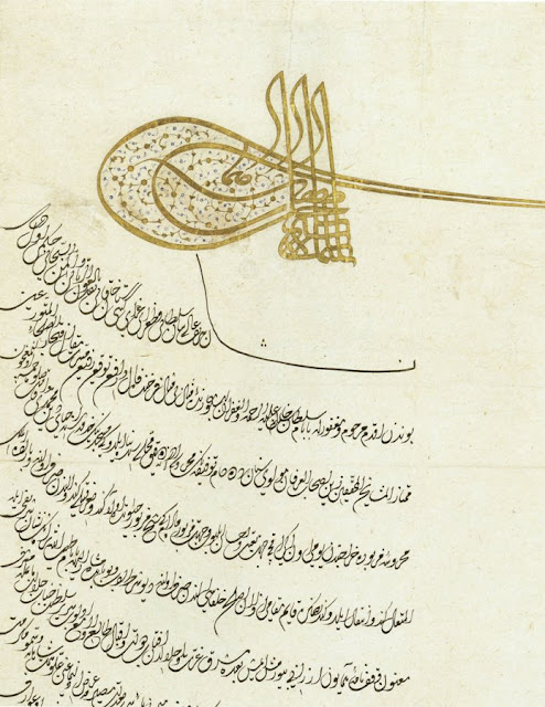 "This royal decree, or ferman, features 24 lines of divani script written in sefine (""boat"") form, in black ink powdered with gold. It bears the seal, or tugra, of sultan Suleyman the Magnificent."