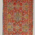 This carpet is known as a Star Ushak, from the star shape of its medallions and the weaving center from which it originates. In the use of a primary star-shaped medallion on a field containing a secondary floral scroll, the Anatolians no doubt were influenced by northwest Persian book design, as seen in buildings or illumination, or by Persian medallion carpets. Unlike the Ottoman medallion carpets of Cairo and Bursa, the ground scroll here is secondary to the medallion scheme. The blue medallions on the red ground are the traditional colors of these carpets. Star Ushaks, extremely popular in the West and copied there, are portrayed in European paintings as early as the second quarter of the sixteenth century.