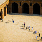 A private tour of the Mosque of ibn Tulun was passing through while Kiran, Sofi and I were lounging up in the tall minaret.  The girls mentioned how they looked like ants this high up... which is pretty accurate I'd say!Ants of ibn Tulun :: © Asim Bharwani ::