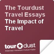 The Tourdust Travel Essay Series Logo