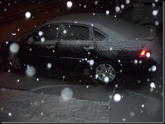 The new whip, 07 Impala LTZ. Look at the fxckin' snow comin' down. And it's gettin' worse. Fxck