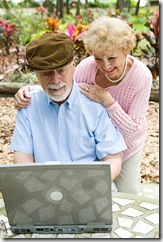 Senior Couple on Computer - Vertical
