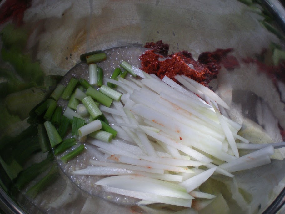 Pastes, radish and scallions go into a bowl