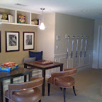 Basement game area. Wainscoting continues around the basement.