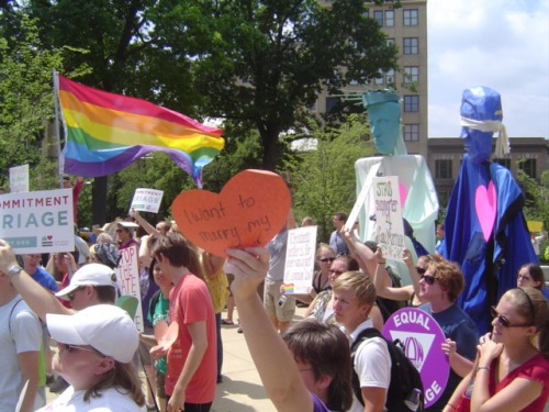 image of people protesting a rally of the National Organization for Marriage on the steps of the capital building, Madison WI