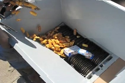 image of Twinkies being fed to an industrial-strength shredder