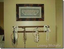 Antique towel rack used as for necklaces...