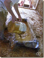 Putting clay slip into the trough