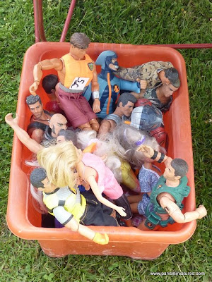 Dolls in a bucket
