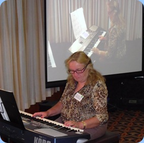 Desiree Barrows playing Len Osbourne's keyboard. Desiree has the same model herself and played very well for her debut at the Club!