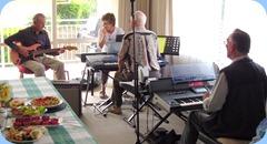Brain Gunson (guitar), Denise Gunson, Peter Brophy and Roy Steen in foreground preparing their next song