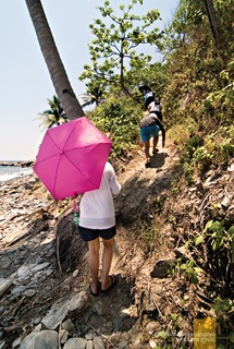 Clambering Up from the Rocky Beach En Route to Apyas Waterfalls