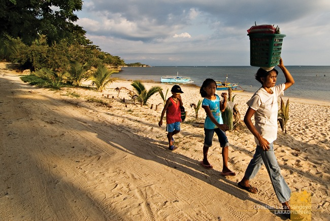 A Family Heading Off with their Wares at Tambobong Beach