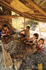 A Family Sorting Pebbles for Selling at Abra de Ilog