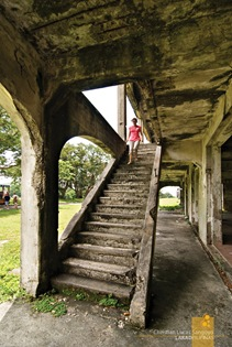 A Visitor Exploring the Second Floor at Corregidor's Mile Long Barracks