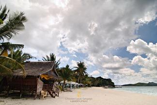 Beach Huts on the Seafront of Malcapuya Island