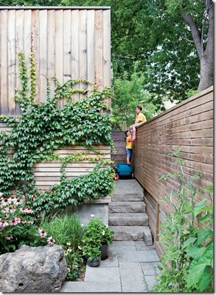galley-house-exterior-ivy-garage-with-boys-on-fence