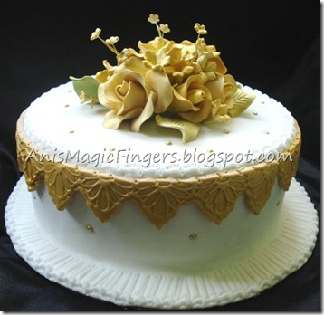 white and gold wedding cake for hantaran ordered from Lynn tauke Insurance