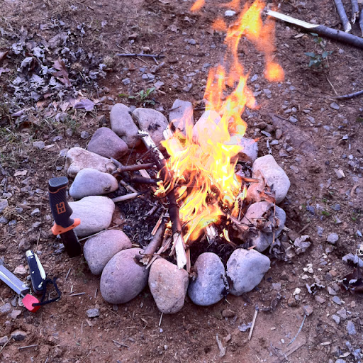 I have a little fire ring out back of my house and when I get free time like will go back and build a little fire to relax next to. On this particular occasion I was testing out my Gerber Bear Grylls knife. I processed a decent amount of wood. It did pretty well.