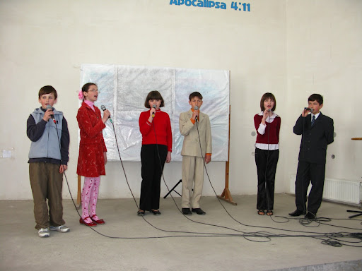 Sunday School children singing for orphans