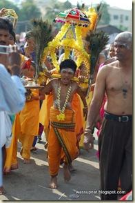 carrying the mini kavadi