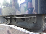 Clips on the left and right sides that hold the bumper