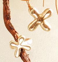 cruces redondeadas joyas de bisuteria   Refinada simplicidad