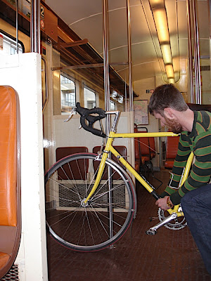 Jefe dismantling his bike on the shuttle to St. Pierre des Corps