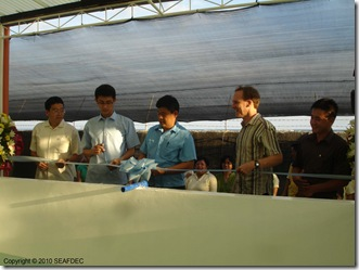Ceremonially opening the new SEAFDEC sea cucumber hatchery are (from left to right): SEAFDEC Deputy Chief Dr. Teruo Azuma, JIRCAS visiting scientist Dr. Satoshi Watanabe, SEAFDEC Chief Dr. Joebert Toledo, Dr. David Mills of  WorldFish Center, and Mr. Nguyen Dinh Quang Duy of Vietnam's Research Institute of Aquaculture No. 3