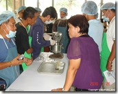 AQD scientist Ms. Myrna Teruel (in violet) supervising the trainees during feed preparation