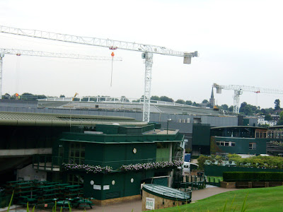 This is Court No. 1 in the foreground and Centre Court getting a roof in the background.