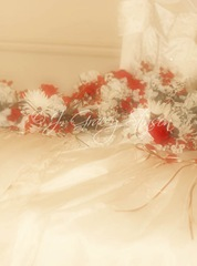 soft romantic image of wedding dress laid on bed with floral bouquet, ©J. Gracey Stinson