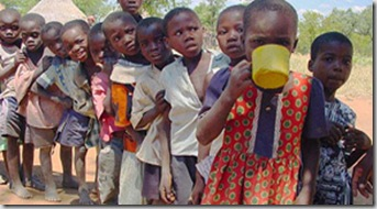 Children line up for a meal at a CARE supplementary feeding program in Masvingo province, Zimbabwe.