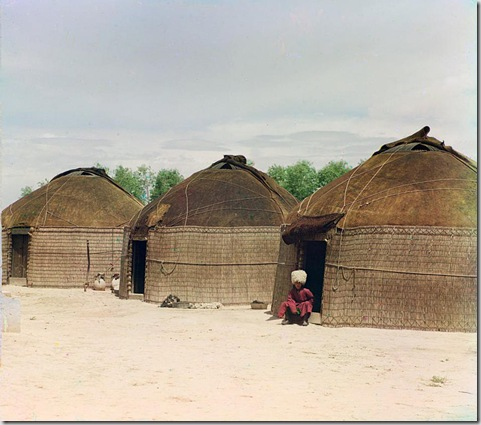 Three yurts, man seated in doorway of yurt in foreground; between 1905 and 1915 Sergei Mikhailovich Prokudin-Gorskii Collection (Library of Congress).