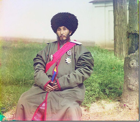 Isfandiyar, Khan of the Russian protectorate of Khorezm (Khiva), full-length portrait, in uniform, seated on chair, outdoors; between 1910 and 1915 Sergei Mikhailovich Prokudin-Gorskii Collection (Library of Congress).