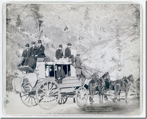 "Title: ""The Deadwood Coach"" Side view of a stagecoach; formally dressed men sitting in and on top of coach. 1889. Repository: Library of Congress Prints and Photographs Division Washington, D.C. 20540"