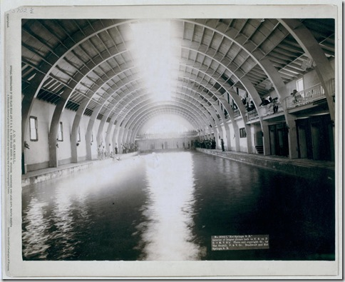 "Title: ""Hot Springs, S.D."" Interior of largest plunge bath in U.S. on F.E. and M.V. R'y Interior view of plunge bath; bathers and spectators standing beside pool. 1891. Repository: Library of Congress Prints and Photographs Division Washington, D.C. 20540"