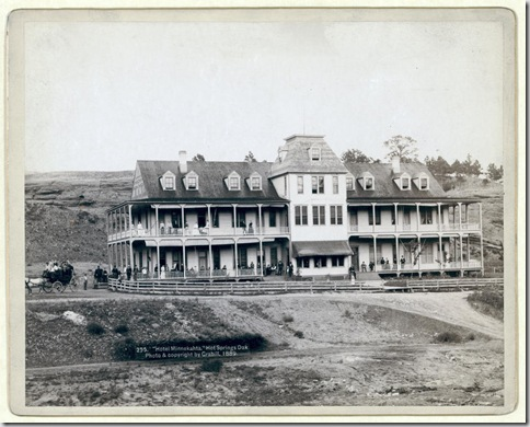 "Title: ""Hotel Minnekahta,"" Hot Springs, Dak. Front view of hotel with men and women posed on the porches and balcony. 1889. Repository: Library of Congress Prints and Photographs Division Washington, D.C. 20540"