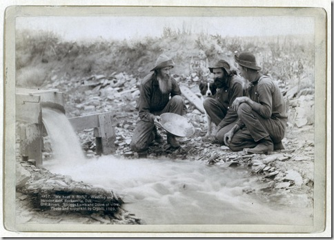 "Title: ""We have it rich."" Washing and panning gold, Rockerville, Dak. Old timers, Spriggs, Lamb and Dillon at work Three men, with dog, panning for gold in a stream. 1889. Repository: Library of Congress Prints and Photographs Division Washington, D.C. 20540"