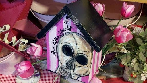 Pink skull birdhouse love kills slowly