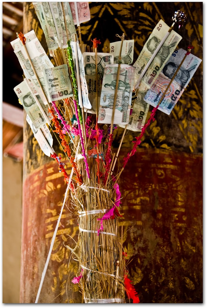 Incense with money at wat