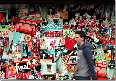 A youth walks past Liverpool Football Club's Anfield Stadium Liverpool, England, Friday, Oct. 15, 2010. (AP Photo/Scott Heppell)