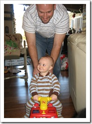 Daddy & Reid on his new firetruck! Dec 2009