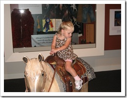 Avery Jane riding a horsey at the Cowgirl Hall of Fame, 6-20-09