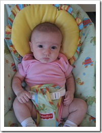 Raquel chilling out in her bouncy seat, 7-8-09